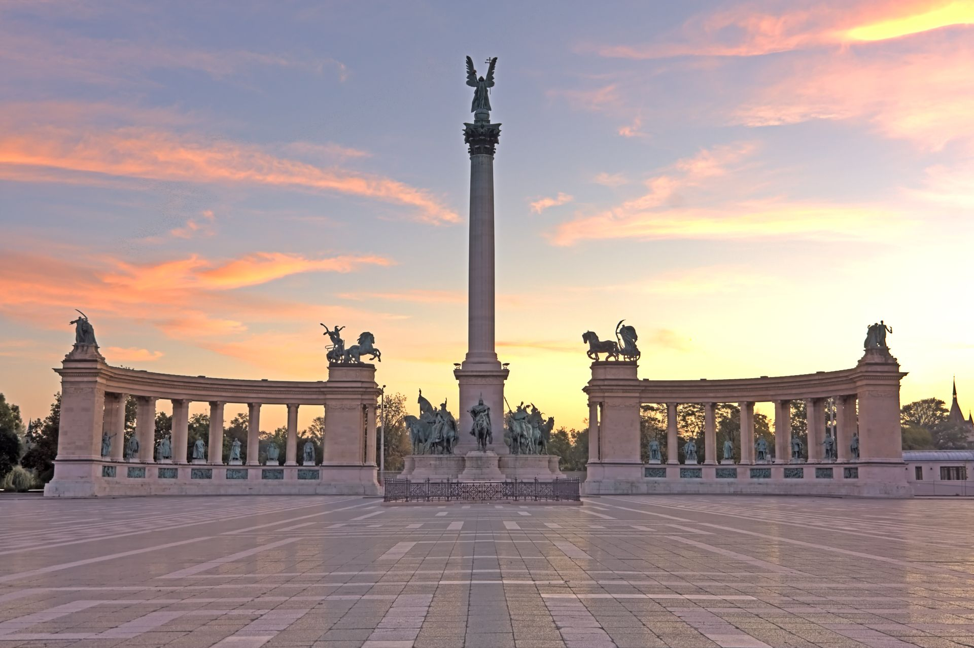 A deserted Heroes square or Hosok ter on Budapest Hungary just as the sun rises